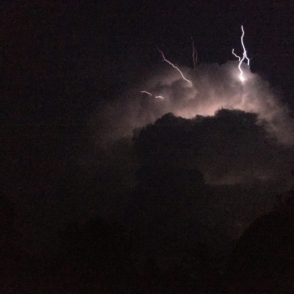Night time clouds illuminated by lightning