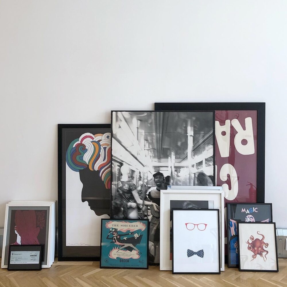 A selection of frames graphic artworks waiting to be hung